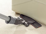 Dual mode floor tool used under sofa