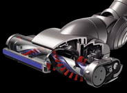 Motorised floor tool with carbon fibre brushes